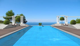 Swimming pool with a view to the sea Royalty Free Stock Images