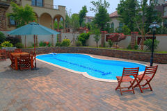 Swimming pool of villa Stock Photos