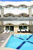 Swimming pool by villa at the luxury hotel Stock Photos