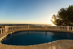 Swimming pool in the villa at sunrise. stock images
