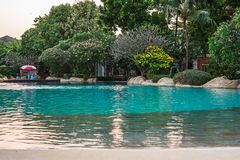 Swimming pool in the village. The swimming pool in the village has a backdrop of trees Stock Photo