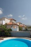 Swimming pool and villas Stock Image