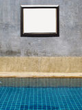 Swimming pool and wall with Picture frame Royalty Free Stock Images