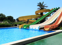 Swimming pool with water attractions at the resort. Stock Photos