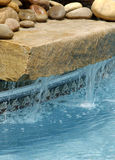 Swimming Pool Water Feature. Swimming Pool with a stone waterfall feature royalty free stock photos