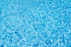 Swimming pool water with shiny sunlight reflection Stock Photos