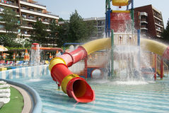 Swimming pool with water slide royalty free stock photography