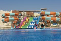 Swimming pool with water slides in a luxury tropical hotel resort stock image