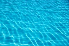 Swimming pool water sun reflection background. Ripple Water. stock images