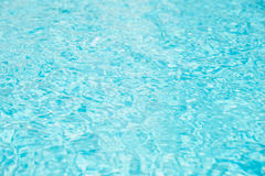 Swimming pool water wave with sun reflections. royalty free stock photos