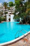 Swimming pool with waterfall Stock Photo