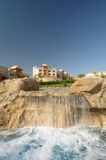 Swimming pool waterfall Stock Image