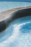 Swimming pool waterfall. Close view of a swimming pool waterfall Royalty Free Stock Photo
