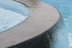 Swimming pool waterfall. Close view of a swimming pool waterfall Royalty Free Stock Images