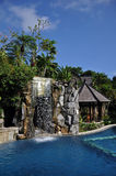 Swimming pool with waterfall. In exotic resort in island Bali, Indonesia stock image