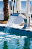 Swimming pool waterfall jet Royalty Free Stock Photos