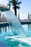 Swimming pool waterfall jet Stock Photo