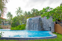 Swimming pool and waterfall Royalty Free Stock Photography