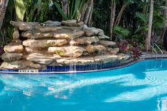 Swimming Pool and Waterfall Stock Photos
