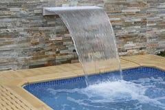 Swimming Pool Waterfalls Stock Images