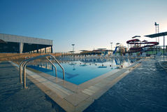 Swimming Pool with waterside during twilight Stock Image