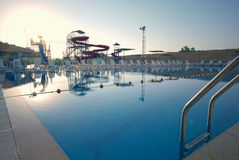 Swimming Pool with waterside during twilight Royalty Free Stock Images