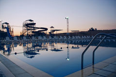 Swimming Pool with waterside during twilight Stock Images