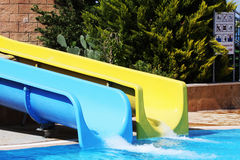 Swimming pool with waterslides Stock Image
