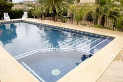 Swimming Pool With Jacuzzi Stock Photo