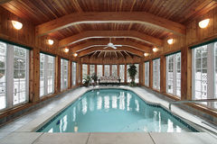 Swimming pool with wood ceiling beams royalty free stock photography