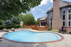Swimming pool with wood deck royalty free stock images