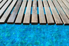 Swimming pool, a wooden bridge Royalty Free Stock Photo