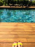 Swimming pool and wooden deck stock photography
