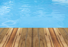 Swimming pool and wooden deck backgrounds. Swimming pool and wooden deck ideal for backgrounds royalty free stock images
