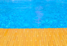Swimming pool and wooden deck for backgrounds Royalty Free Stock Images