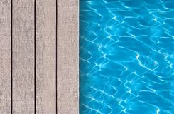 Swimming pool and wooden deck ideal Stock Images