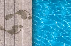 Swimming pool and wooden deck ideal Stock Image