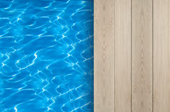 Swimming pool and wooden deck ideal for backgrounds Stock Photography