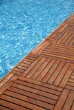 Swimming pool and wooden floor Royalty Free Stock Photography