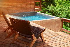 Swimming pool in wooden terrace royalty free stock image