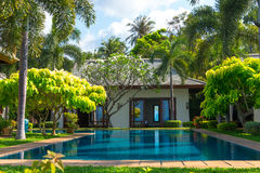 Swimming pool and yard of the luxury villa, Samui, Thai. Land royalty free stock photography