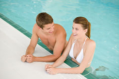 Swimming pool - young cheerful couple have fun Royalty Free Stock Photos