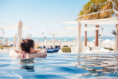 At The Swimming Pool Stock Photography