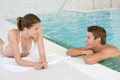 Swimming pool - young happy couple relax Stock Images