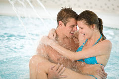 Swimming pool - young loving couple have fun Stock Photography