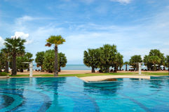 Swimming pools at the beach of luxury hotel Royalty Free Stock Image