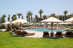 Swimming pools and beach at the luxury hotel Stock Images