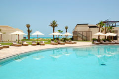 Swimming pools and beach at the luxury hotel Royalty Free Stock Photography