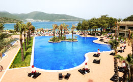 Swimming pools and beach at luxury hotel Royalty Free Stock Image