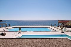 Swimming pools of luxury holiday hotel, amazing nature view landscape sea. Relax near two swimming pools with handrail. Swimming pools of luxury holiday hotel stock images
